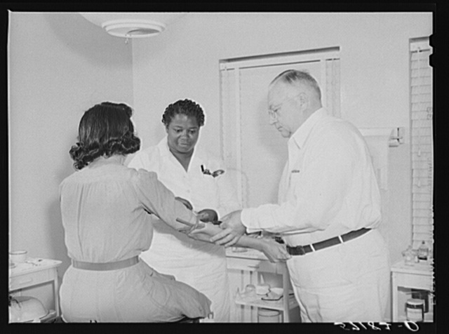 Taking a Wasserman blood test in clinic for agriculture workers. Okeechobee migratory labor camp, Belle Glade, Florida