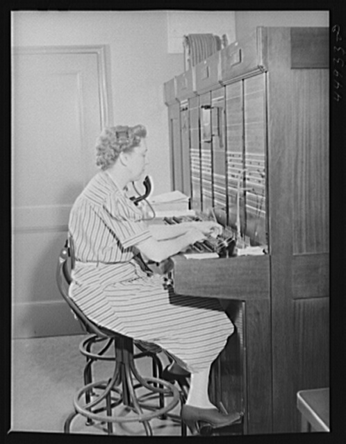 Telephone operator at the airport switchboard. Municipal airport, Washington, D.C.