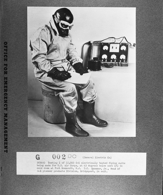 Testing one of 12,000 General Electric electrically heated flying suits being made for the U.S. Air Corps, at sixty-three degrees below zero (Fahrenheit) in cold room at Fort Monmouth, New Jersey. D. C. Spooner, Jr., head of General Electric pioneer products division, Bridgeport, in suit