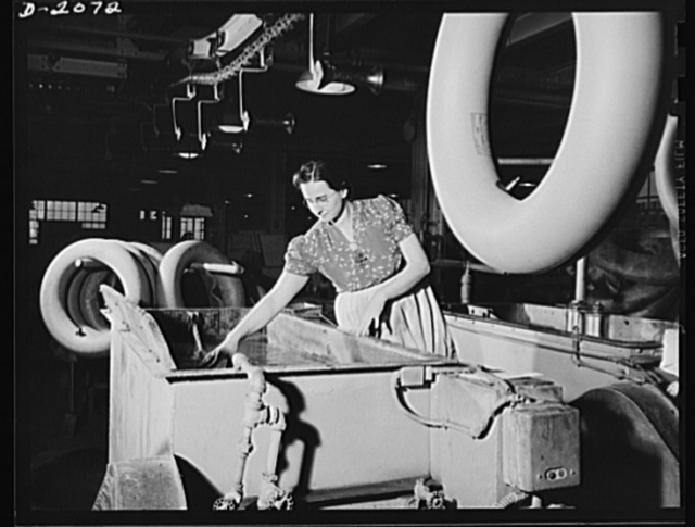 Testing the finished tube before packing. Fully inflated, every tube is tested by immersion in water before being dried, and packed for shipment. Rarely do workers find an imperfect tube, but this extra precaution is taken in every instance--just in case. Firestone (General) Tires, Akron, Ohio