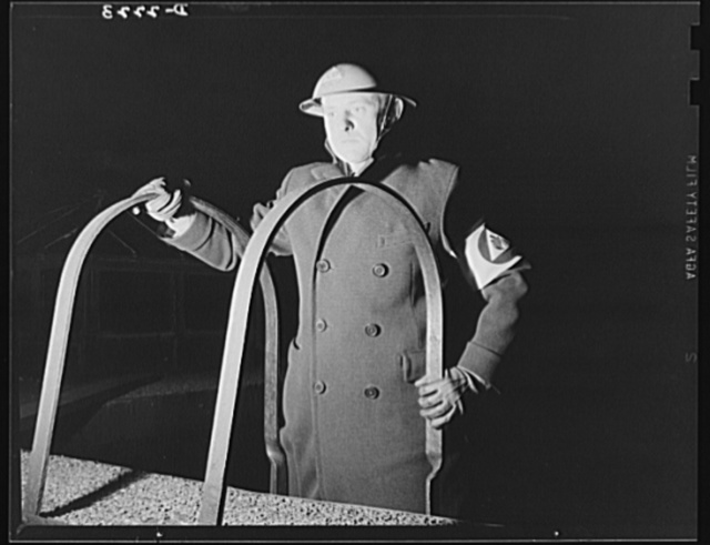 The air raid protective services. Ever on the alert is the firewatcher, who mounts to a rooftop at the first alarm. He is responsible for detecting incendiary bombs, and is trained in the methods of fighting them