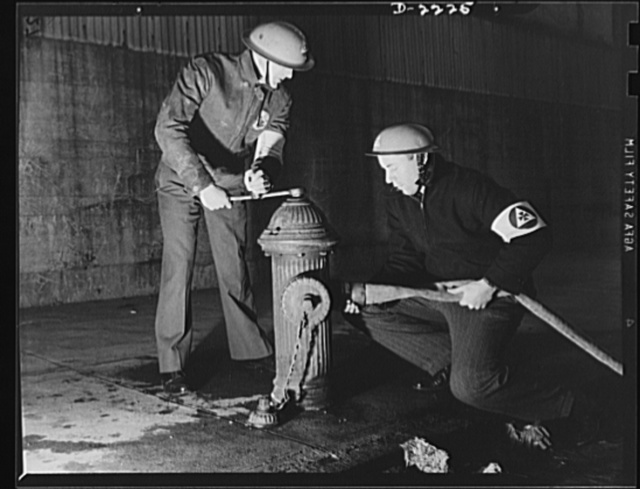 The air raid protective services. The speedy laying and coupling of firehose is often a difficult task, but it is essential if the auxiliary firemen are to function to the best advantage. They must learn to clamber like monkeys over debris, and must learn to estimate the strength of standing sections of bombed buildings