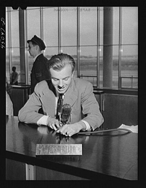 The C.A.A. announcer. He speaks from the central information desk and his voice is heard thru loudspeakers in every corner of the building and on the field. Municipal airport, Washington, D.C.