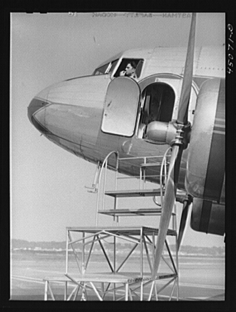 The captain is in his place and in a few minutes the plane will take-off. Municipal airport, Washington, D.C.