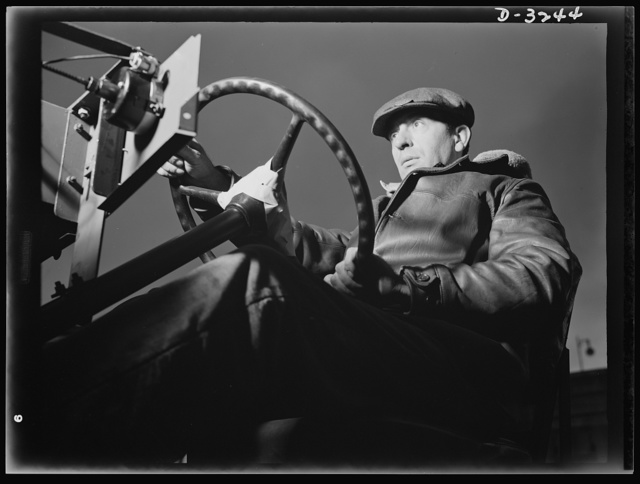 The chassis of an Army halftrac scout car get a workout. When this test driver at a large Midwest plant has put the machine through its paces, he'll know if the machine meets the exacting specifications of the Army. White Motor Company, Cleveland, Ohio