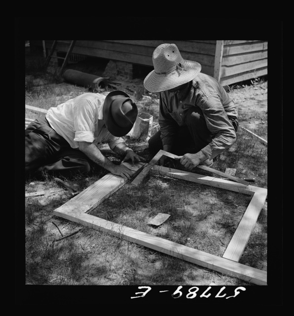 The corner is squared and reinforcement nailed over joints. Screen door construction demonstration. Charles County, La Plata, Maryland