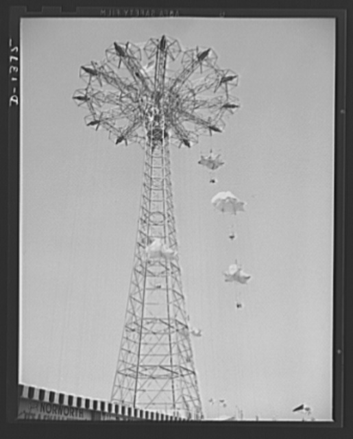 The four freedoms. Let'er rip, and carefree couples glide earthward from the top of Coney Island's famous parachute jump. Not shown are the milling crowds below, who enjoy the carefree screams of the people on the chutes as much as the brave chutists themselves