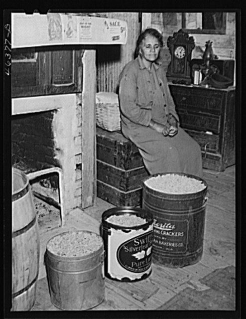The mother of Mr. Edgar Jones, FSA (Farm Security Administration) client with peanuts that are being stored for the winter. Woodville, Greene County, Georgia