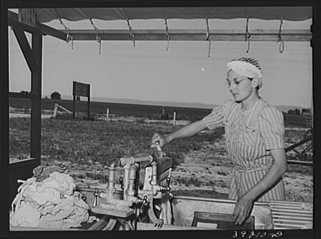 The nurse does her laundry at the FSA (Farm Security Administration) migratory labor camp mobile unit. Wilder, Idaho