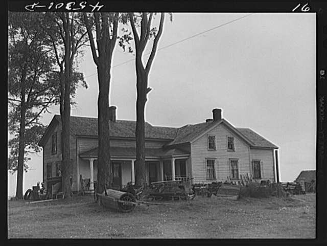The O'Connell homestead in the Pine Camp expansion area. The articles outside the house are to be sold at auction in preparation for moving out of the area. Near Pine Camp, New York