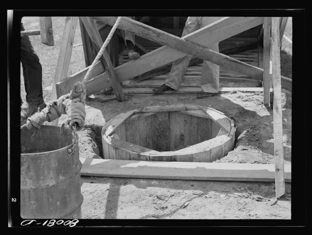 The old wood curbing permitted surface water to wash in between cracks. Safe well demonstration near La Plata, Maryland. Charles County