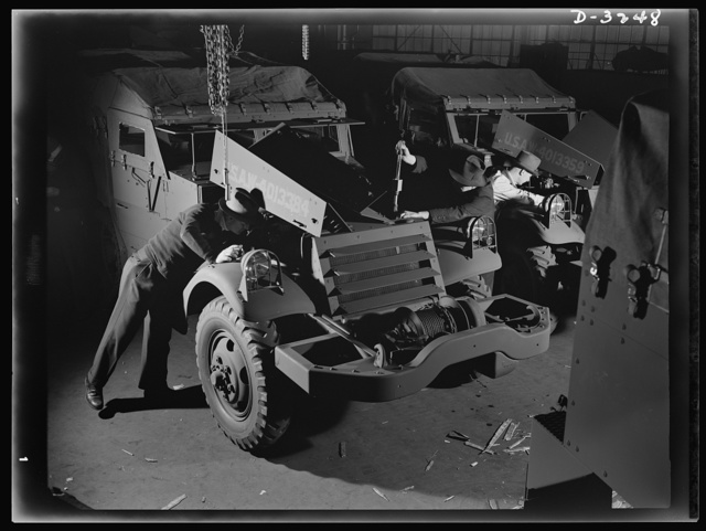 The ordnance department must satisfy itself that every halftrac scout car turned over to it by a Midwest manufacturer is fit for Army duty. The department's own inspector gives it a thorough going over from bumper to bumper. White Motor Company, Cleveland, Ohio