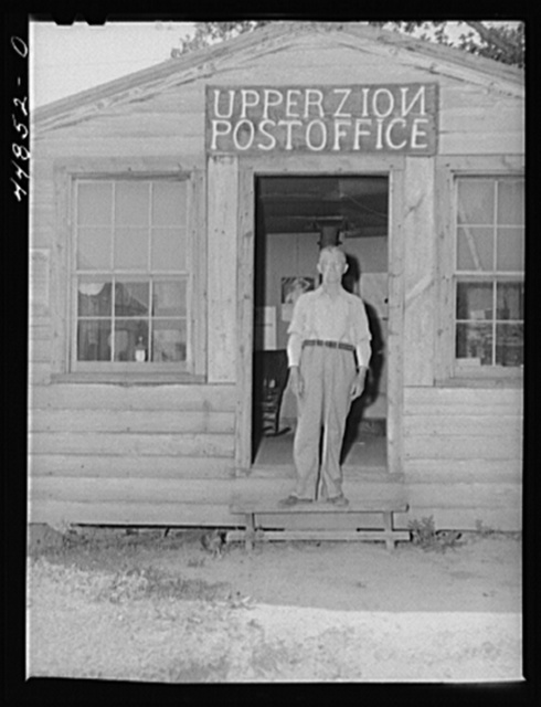 The postmaster of Upper Zion, Virginia. When the town is evacuated to make room for the Army maneuver grounds, he will be out of a job