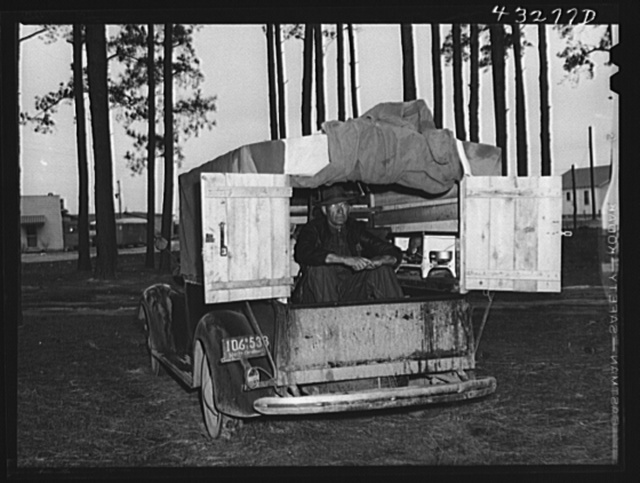 The rear end of this man's truck is his home. It includes a bed, small stove, and his personal belongings. An ex-leather worker, he was employed as a carpenter at Fort Bragg, North Carolina. Expecting to be laid off any day, he was planning to go back to his home in Hickory, North Carolina (about two hundred miles away). Near Fayetteville, North Carolina