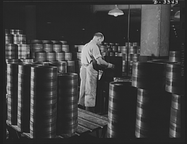 The tracks for Army halftrac cars run over bogie wheels which distribute the load and absorb shock through the springs on which they are mounted. The steel bases for these bogie wheels undergo inspection at a Midwest tire plant engaged in halftrac production. Goodrich, Akron, Ohio