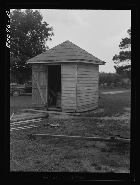 The water from this well is unsafe because surface water washes filth through wooden curbing despite the well house. Safe well demonstration near La Plata, Maryland. Charles County