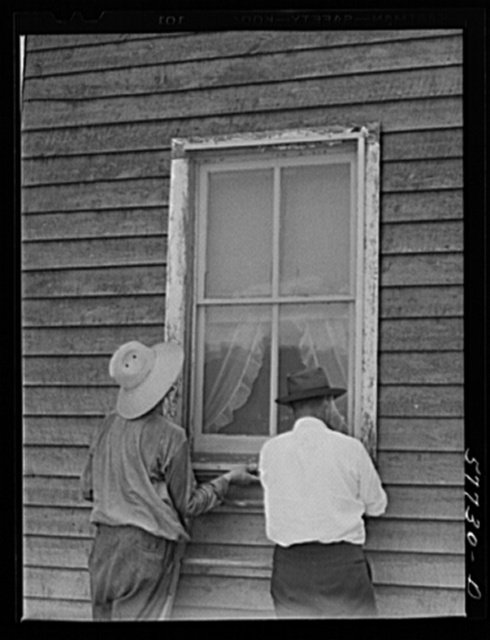 The window is screened except for nailing the last window strip. Screening demonstration. Charles County, La Plata, Maryland
