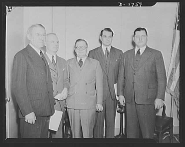 These five members of the National Defense Mediation Board were sitting for the first time on the board in October 31, 1941, when hearings began on the captive coal mine situation. They are, left to right: Frederick R. Fales, Frazier D. MacIver, George Googe, Attorney Francis W.H. Adams and William A. Calvin