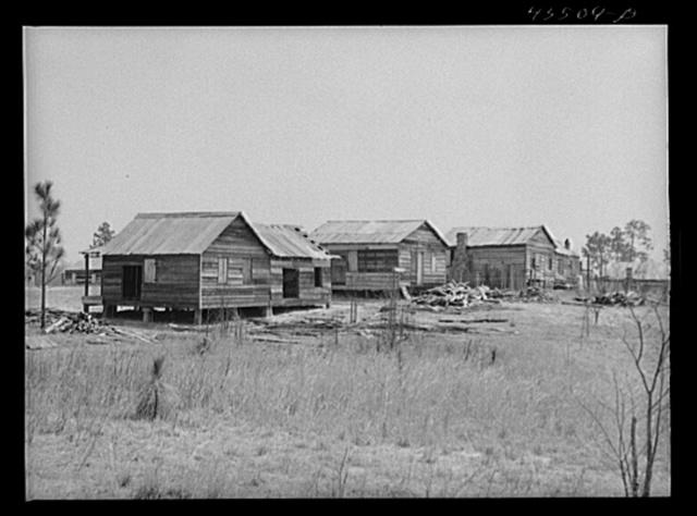 These houses were on an eight acre plot where eight Negro families were resettled by a landowner whose plantation was to be flooded by the Santee Cooper navigation project. Near Moncks Corner, South Carolina