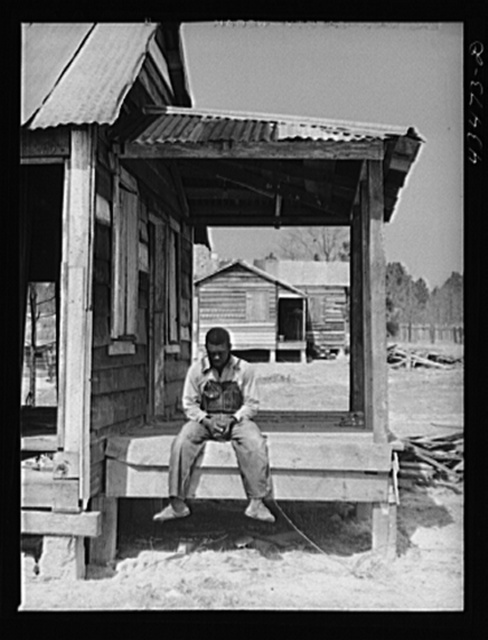 These houses were on an eight acre plot where eight Negro families were resettled by a landowner whose plantation was to be flooded by the Santee-Cooper navigation project. Near Moncks Corner, South Carolina