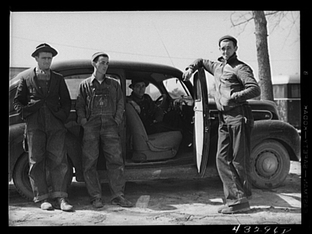 These men stopped at a trailer settlement to see about buying a trailer. They were very uncertain about how long their work would continue at Fort Bragg. Near Fayetteville, North Carolina