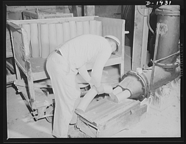 This is the exit end of a pug mill which prepares the plastic clays used in forming various articles of chinaware. Shenango Pottery Works, Newcastle, Pennsylvania