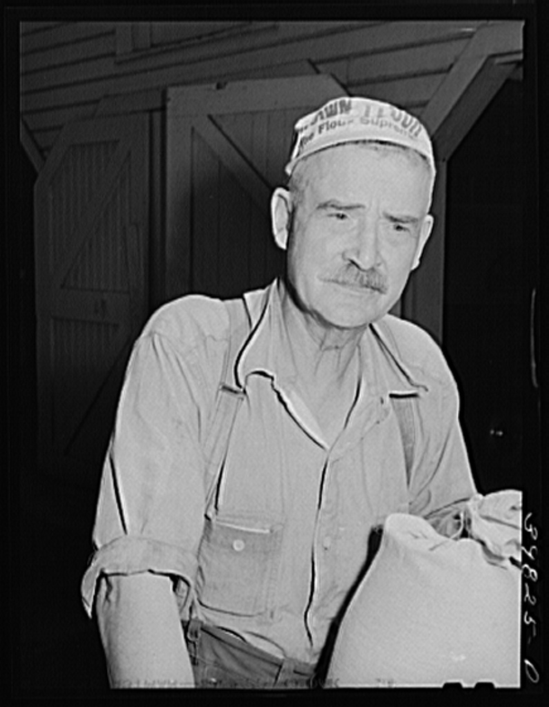 This man gathers samples of wheat from all elevators in three counties in the vicinity of Walla Walla, Washington. The samples are gathered for the Walla Walla Grain Growers Association, state inspectors and wheat brokers