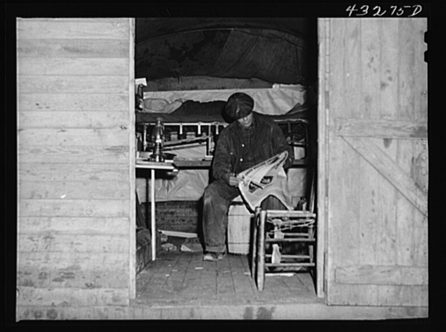 This man is a carpenter at Fort Bragg, North Carolina. This converted truck is his home. The interior of his truck was more roomy than most of the cabins that had been built at the camp where he was staying. At a settlement near Silver Lake, North Carolina (about ten miles out of Fayetteville, N.C.)