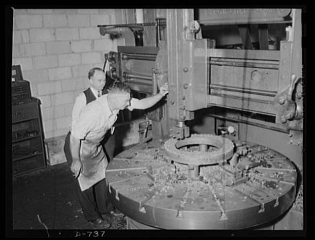 This turning mill is machining a steel index fixture for another machine. Plant of Frederick Colman and Sons, Inc., Detroit, Michigan