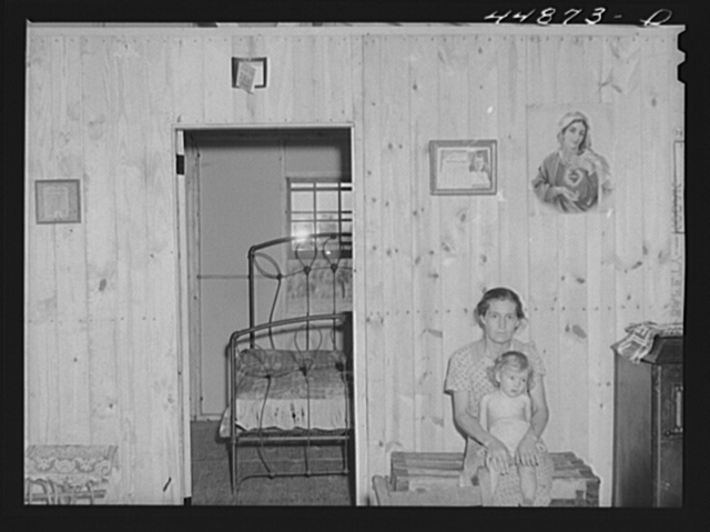 This woman and her family moved from the Army maneuver ground area to a prefabricated house built by FSA (Farm Security Administration) to take care of some of these families. Milford, Caroline County, Virginia