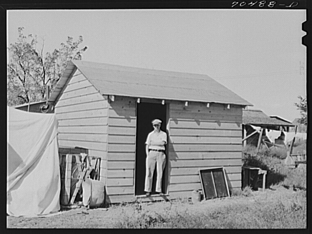 This workman at the Umatilla ordnance depot built this house for his family, spending fifty dollars for materials. He rents building space from homeowner in Hermiston, Oregon. He pays for use of sanitary facilities in house of homeowner; outside privies are provided