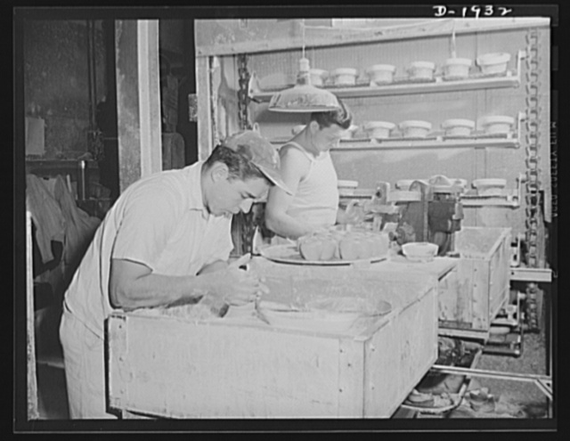 Throwing liners to be used in making medical department coffee cups. Shenango Pottery Works, Newcastle, Pennsylvania