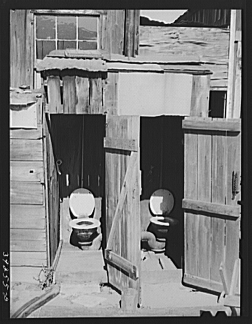 Toilets in court of houses in Mexican section. Cannery workers as well as some agricultural workers and unskilled laborers live in this section
