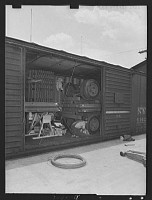 Trailers for defense transportation. Winter Weiss Company, Denver, Colorado. Completed semi-trailer with combination platform stake bodies are loaded into freight cars for delivery to Army Quartermaster Depots. These trailers are intended for general utility use in Army camps and supply depots. They carry a 7,000 ton payload