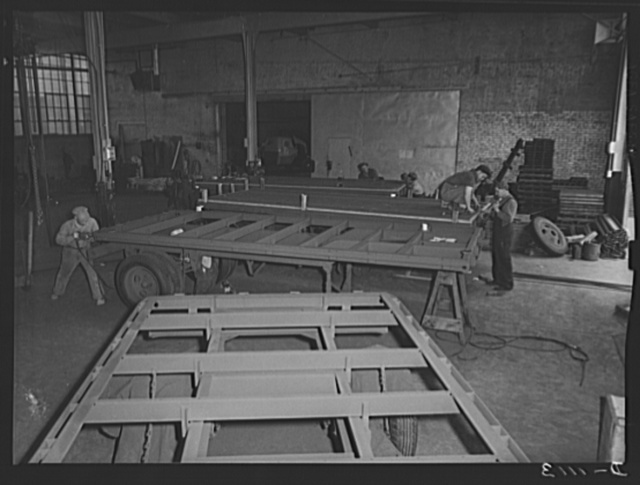 Trailers for defense transportation. Winter Weiss Company, Denver, Colorado. Flooring being laid on semi-trailers for general utility used around Army camps and supply depots. These trailers carry a payload of 7,000 pounds on a combination platform stake body of hardwood