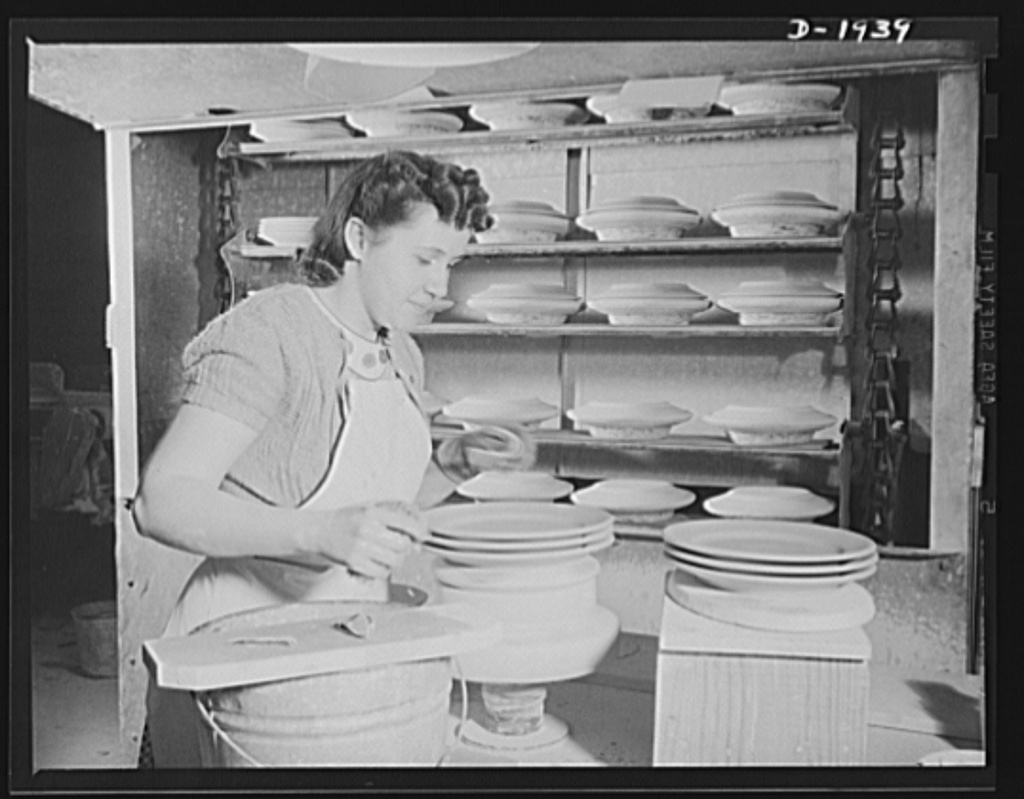 Trimming the edges of plates for the Army Quartermaster. Shenango Pottery Works, Newcastle, Pennsylvania