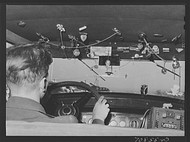 Trinkets in agricultural worker's automobile. Wilder, Idaho