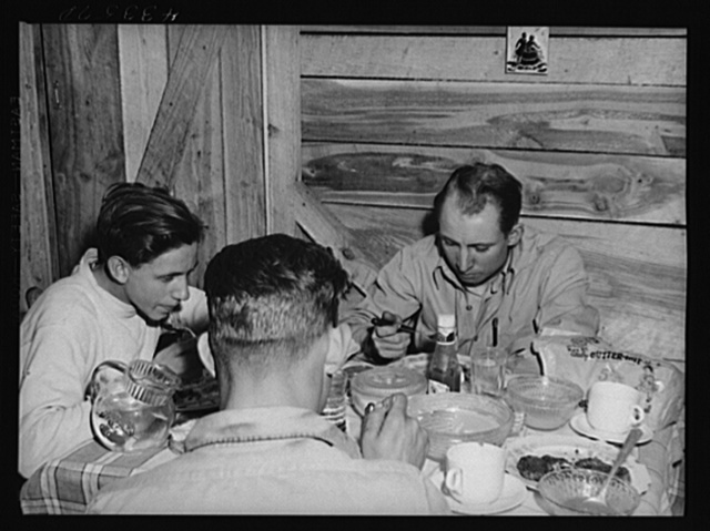 Truckers from Fort Bragg having supper in their shack near Manchester, North Carolina