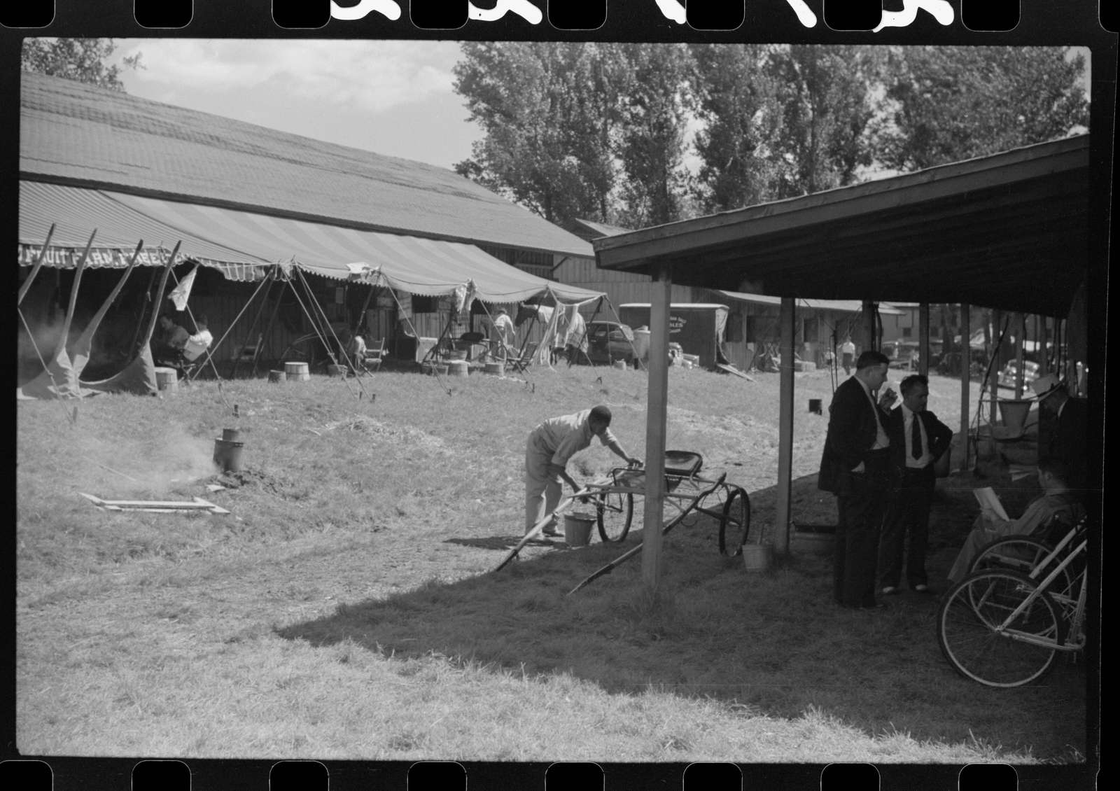 Untitled photo, possibly related to: Spectators at the sulky races at the Rutland Fair, Rutland, Vermont