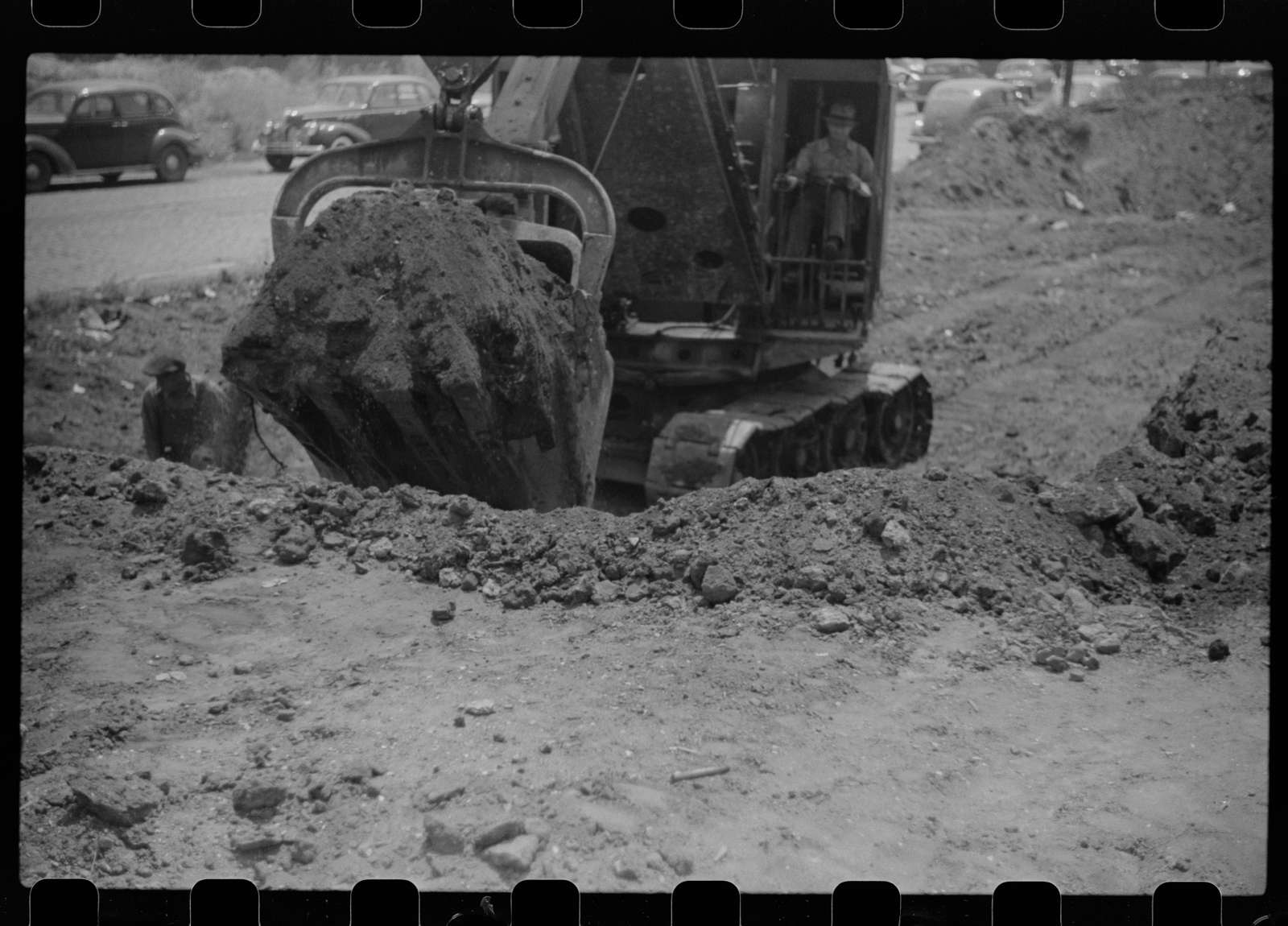 Untitled photo, possibly related to: Steam shovel loading truck, Chicago, Illinois
