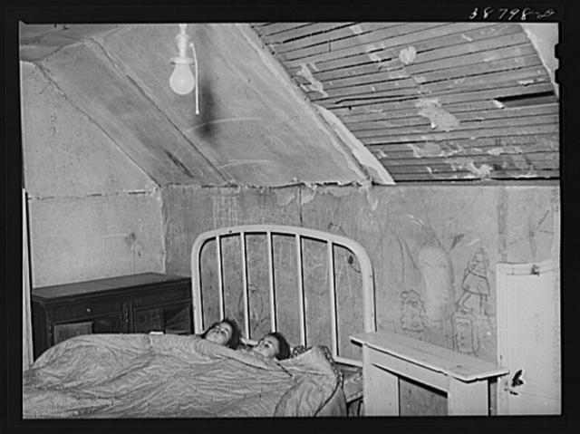 Upstairs bedroom of family on relief. Chicago, Illinois