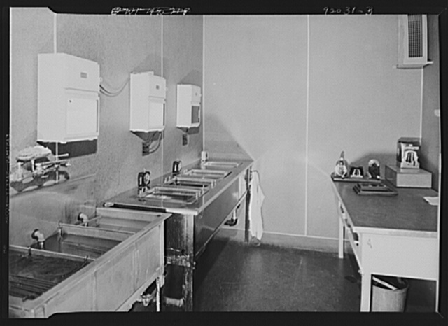 U.S. FSA (Farm Security Administration), later U.S. Office of War Information, photograph laboratory in the Auditor's Building. Washington, D.C. Film developing room