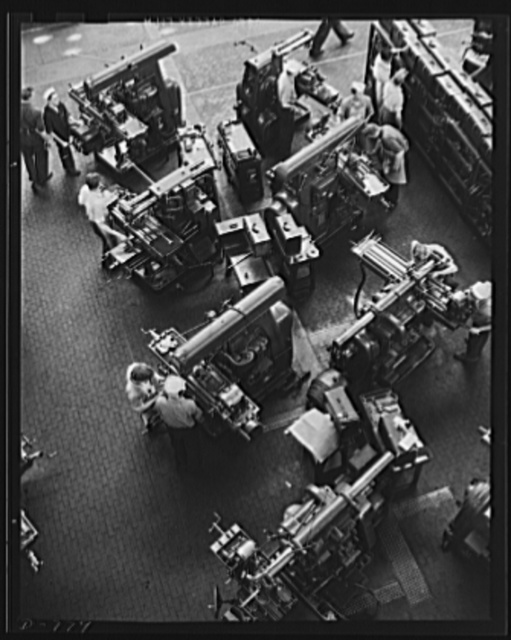 Vast facilities are being used to trin personnel for the U.S. Navy. Here trainees are being instructed in lathe operation by skilled instructor-mechanics. Note Navy machinists at upper left. Ford River Rouge plant, tool and die building