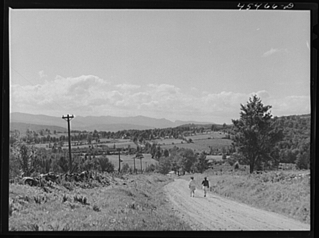 Vermont tourists taking a walk along a county road near Mount Holly, Vermont