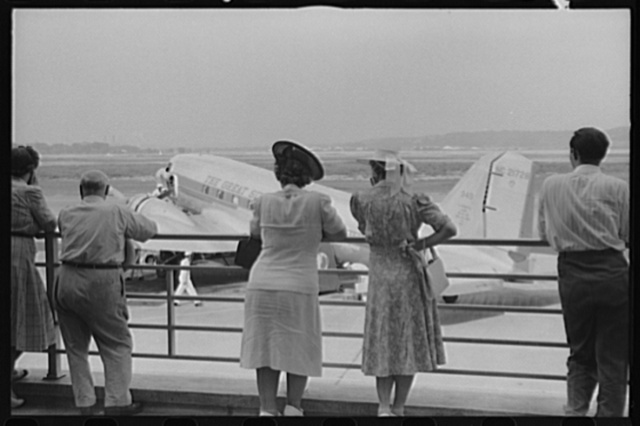 Visitors watching a plane from the observation platform at the municipal airport in Washington, D.C.
