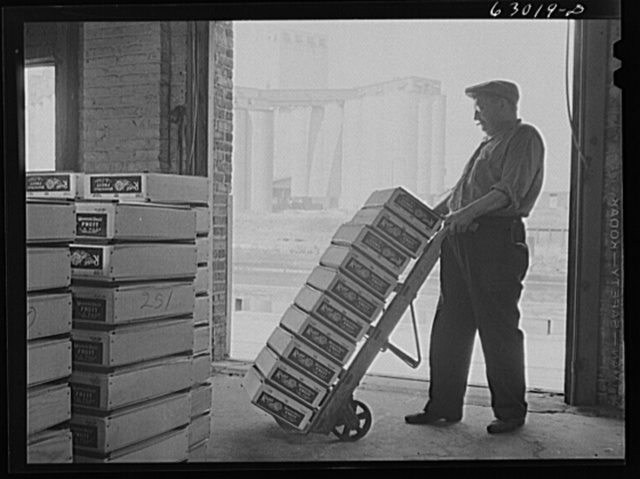 Warehouse at fruit terminal, Chicago, Illinois. Shipments of fruit by commission merchants at auction are loaded onto trucks as soon as drivers and loaders can be notified what shipments have been bought