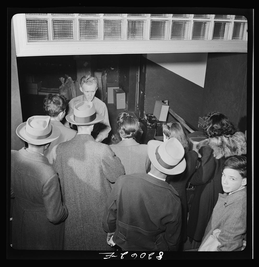 Washington, D.C. Christmas rush in the Greyhound bus terminal. Checking bags