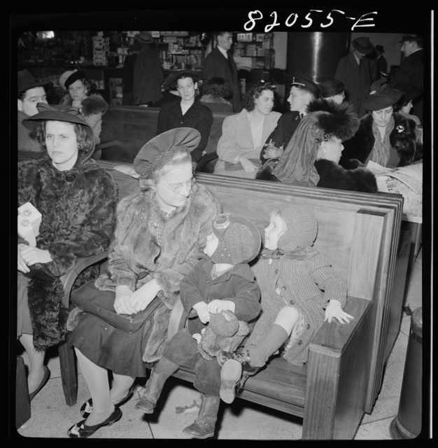 Washington, D.C. Christmas rush in the Greyhound bus terminal. Mother and children waiting for a bus