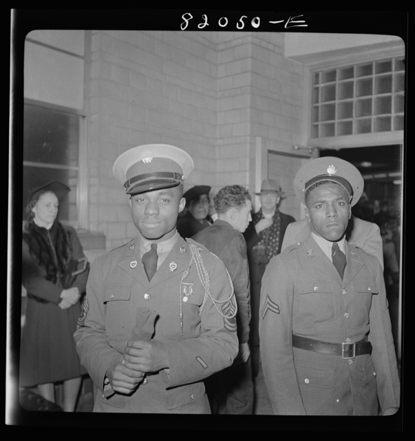 Washington, D.C. Christmas rush in the Greyhound bus terminal. Negro soldiers waiting for a bus