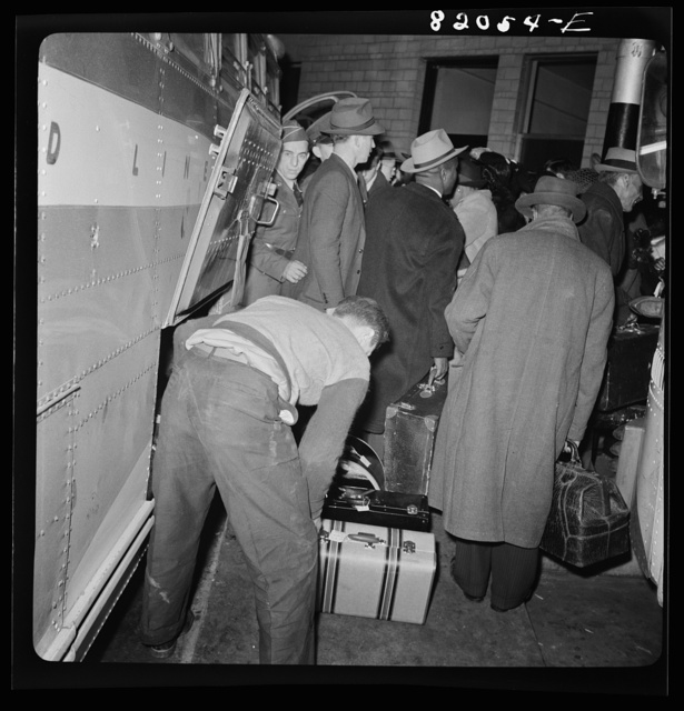 Washington, D.C. Christmas rush in the Greyhound bus terminal. Passengers leaving a bus